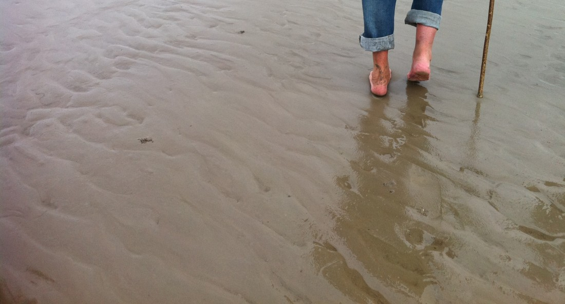 Image of feet walking across Morecambe sands for the Sand Pilot project by Invisible Flock, Sept 2012