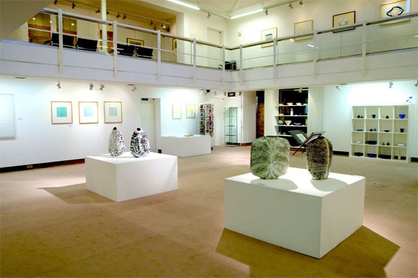 A wide photo showing an art exhibition within the Peter Scott Gallery, Lancaster.